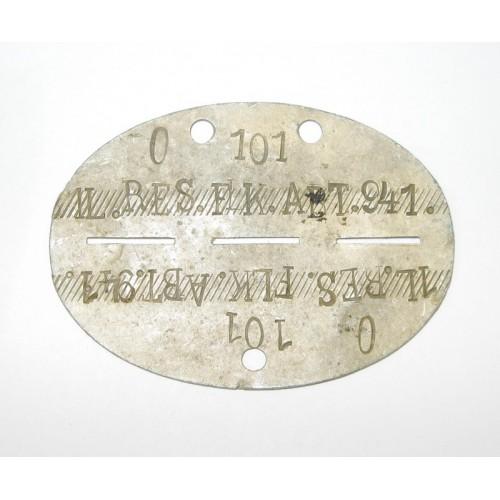 WWII Erkennungsmarke in Tasche, 1/L Res. Flak-Abtlg. 941