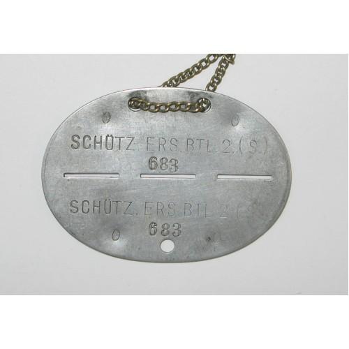 WWII Erkennungsmarke in Tasche, SCHÜTZ. ERS. BTL. 2 (S)
