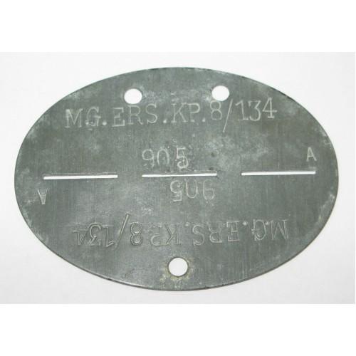 WWII Erkennungsmarke MG. ERS. KP. 8/134
