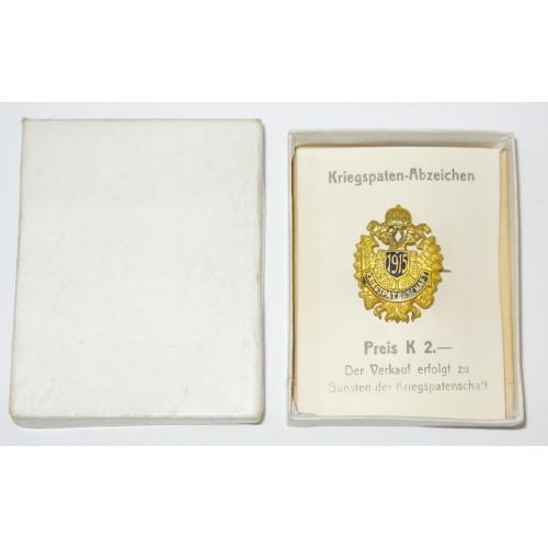 Österreichisches Kriegspaten - Abzeichen  1915 im originalen Verkaufskarton